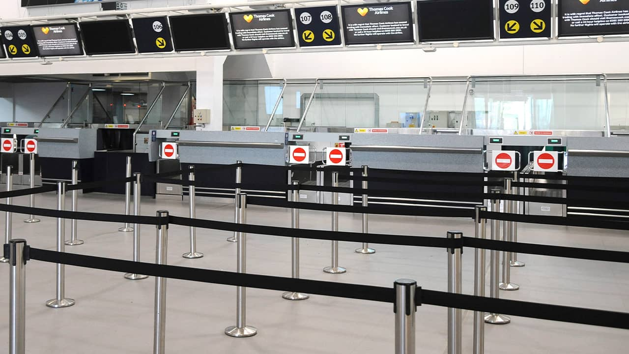 Photo of deserted Thomas Cook check-in counters