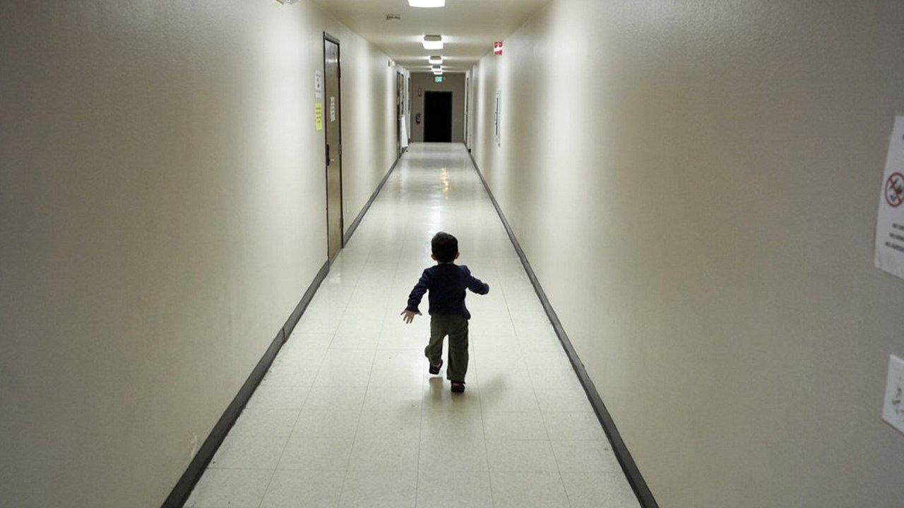 Photo of a child running down a hallway