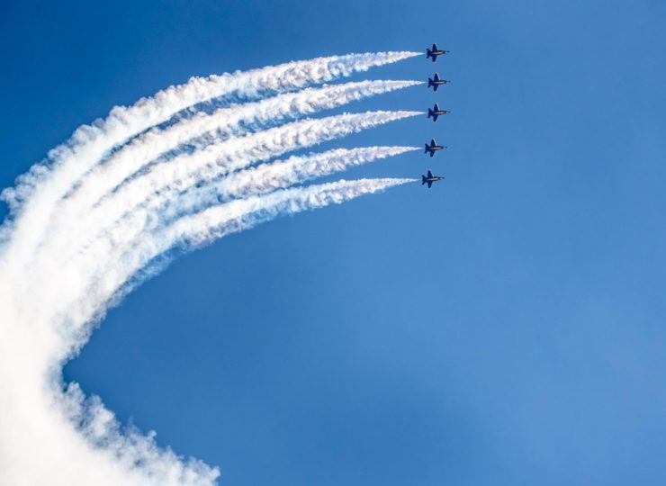 Blue Angels climb to 10,000 feet as they execute their Line Abreast Loop manuever.