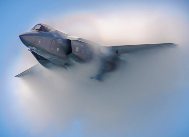 F35 Viper Stealth Fighter creates a vapor cloud in the sky over Huntington Beach during the Great Pacific Airshow.
