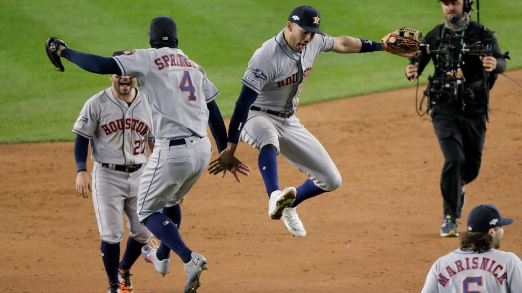Photo of Houston Astros celebrating a victory over the New York Yankees