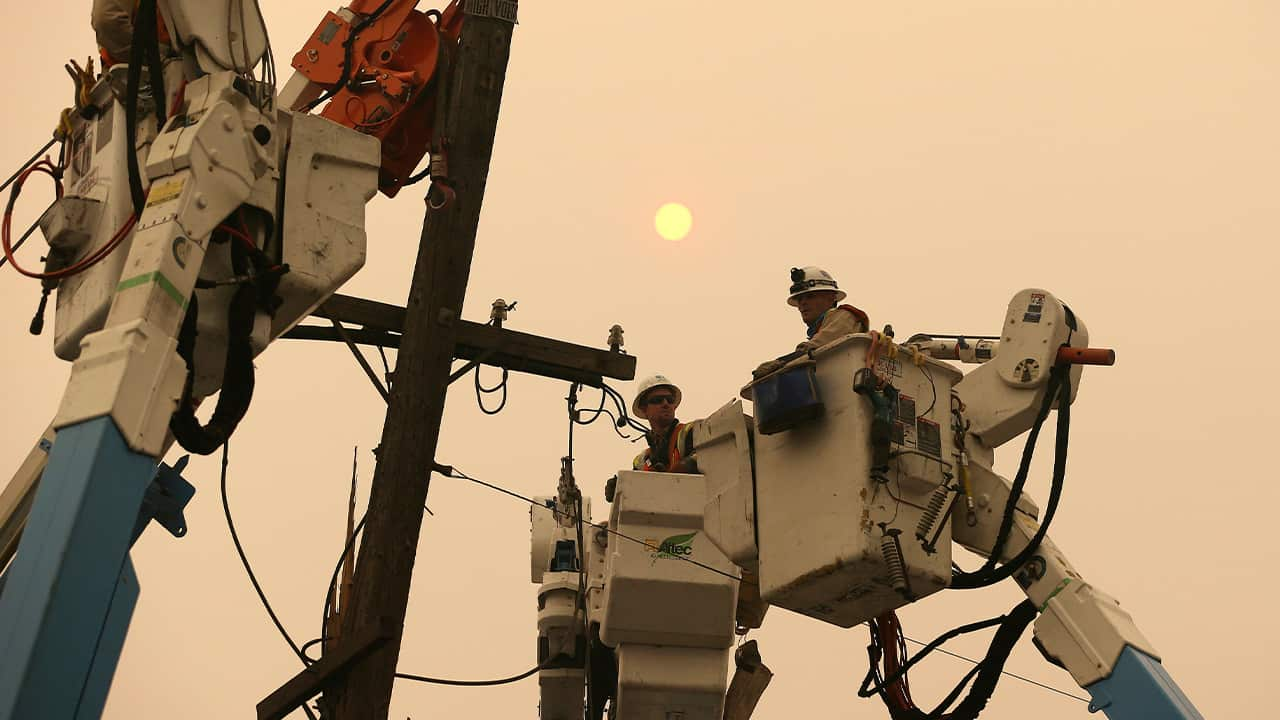 Photo of PG&E workers working to restore power lines in 2018