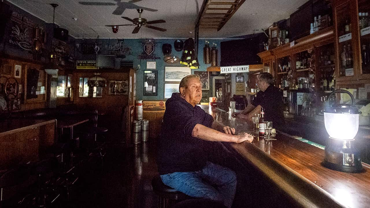 Photo of Joseph Pokorski drinking beer at a bar in Sonoma, Ca.