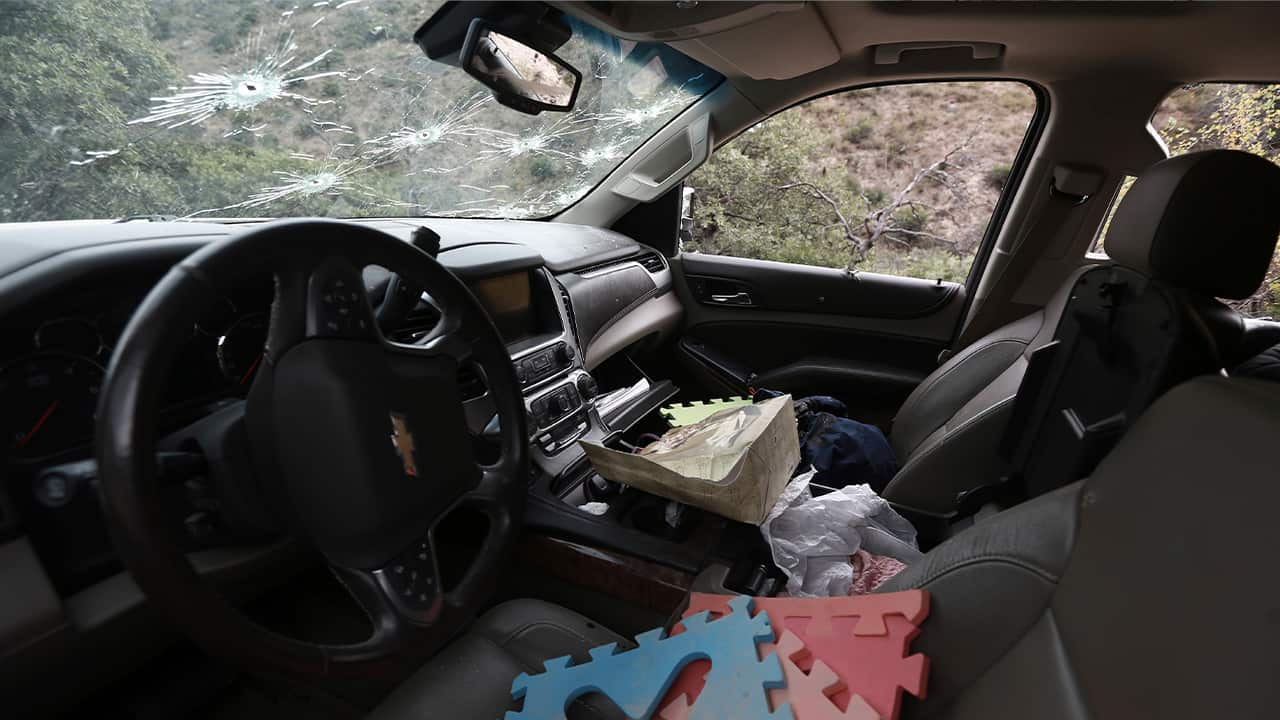Photo of the inside of a bullet-riddled vehicle