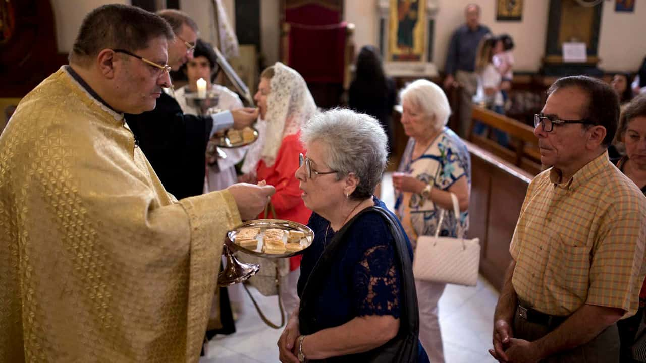 Photo of people partaking in communion at church