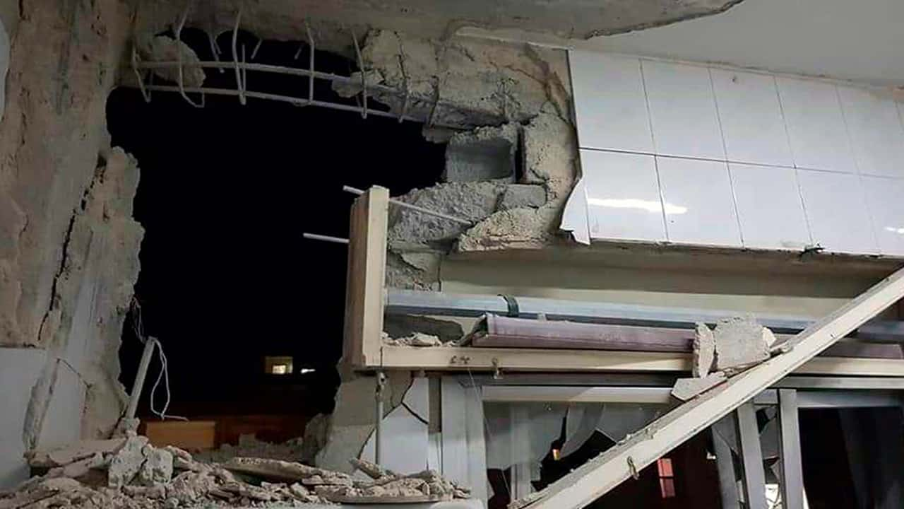 Photo of a damaged building targeted by Israeli missile strikes