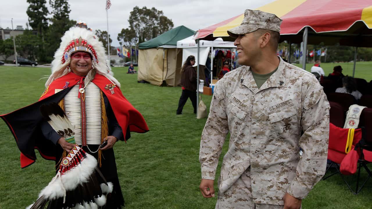 Photo of a Vietnam War veteran talking with Marine Cpl. Frank Tartsah