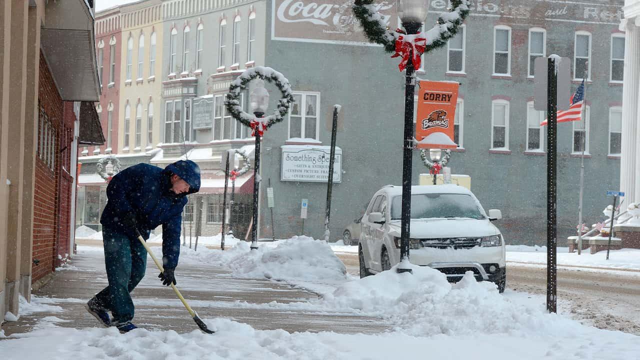 Photo of a man shoveling snow