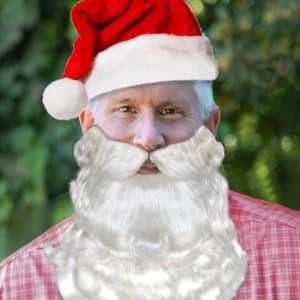 columnist mug of Bill McEwen as Santa Claus