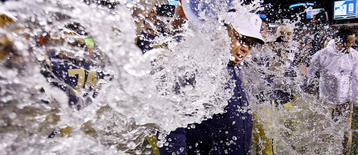 Photo of Ken Niumatalolo getting dunked after the NCAA college football game
