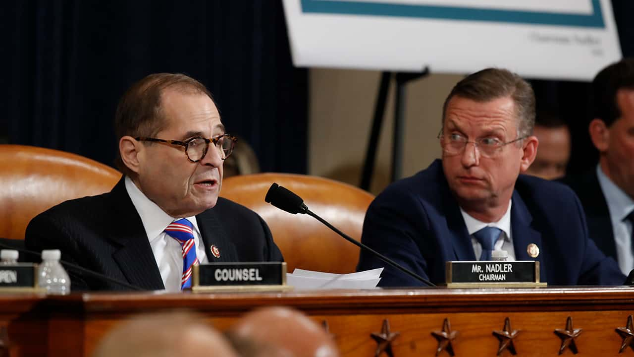 Photo of House Judiciary Committee ranking member Rep. Doug Collins, R-Ga., looking over to Chairman Rep. Jerrold Nadler