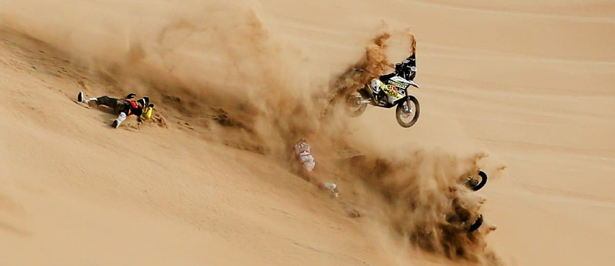 Photo of the Husqvarna motorbike of Jan Brabec flying in the air during the Dakar Rally in Peru