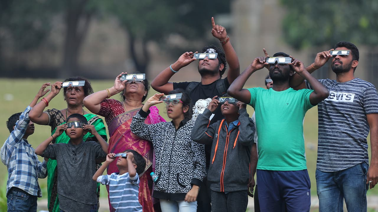 Photo of Indians watching the partial solar eclipse