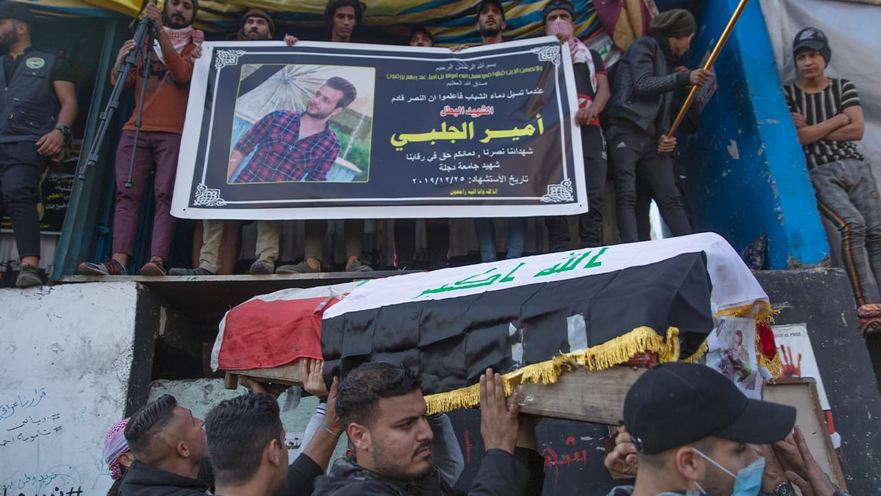 Photo of mourners carrying the body of their fellow protestor