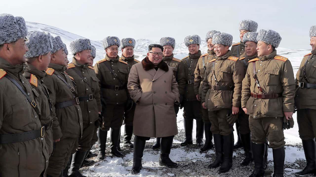 Photo of Kim Jong Un speaking to lieutenants