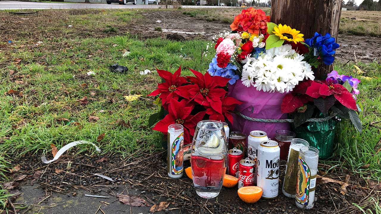Photo of a memorial at the scene where three Christmas tree farm workers were killed