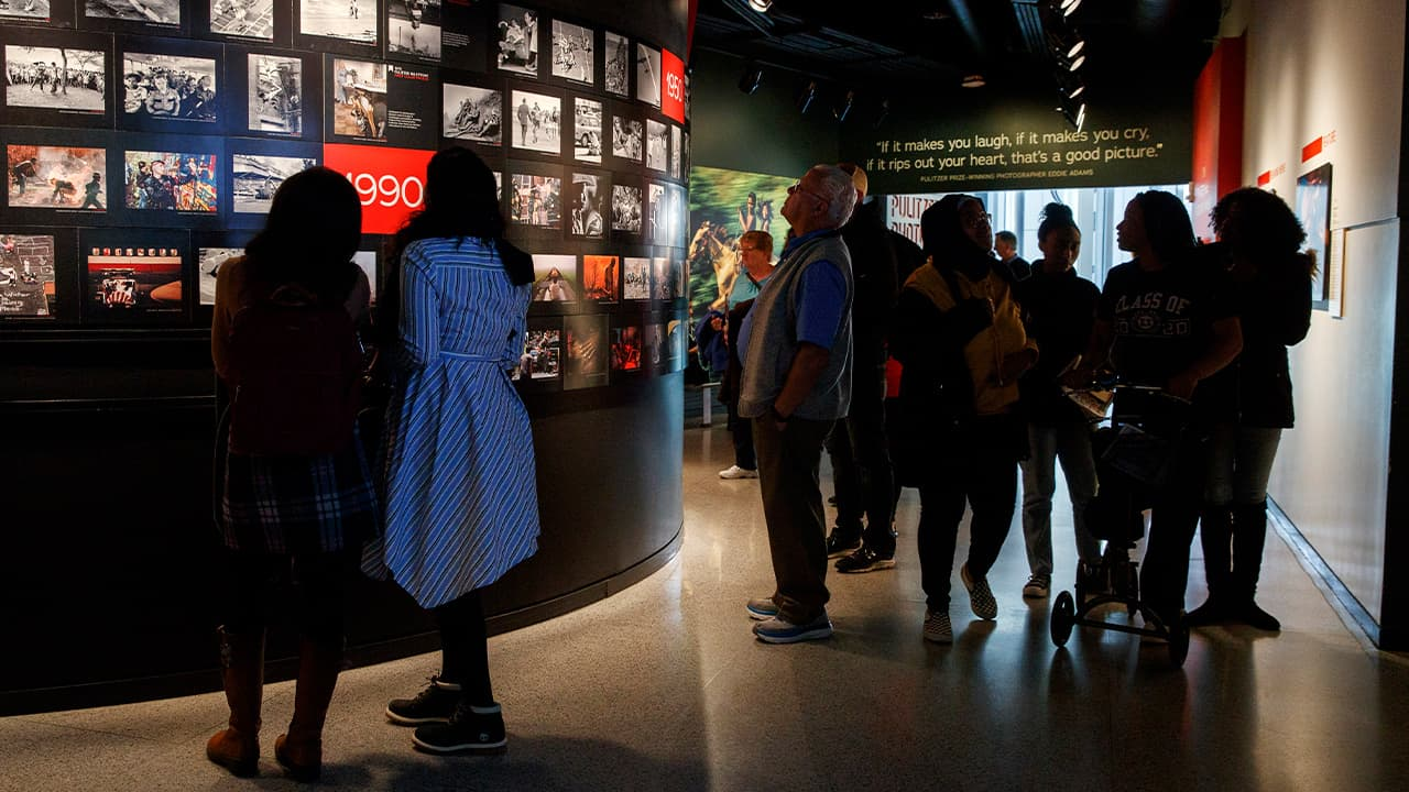 Photo of people visiting the Pulitzer Prize Photography exhibition at the Newseum, in Washington
