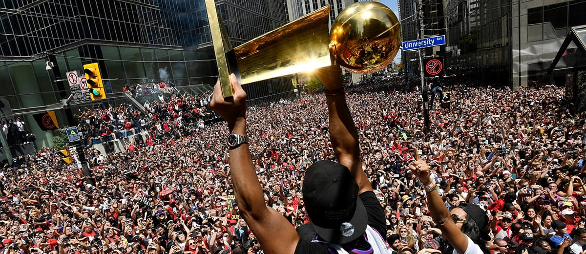 Photo of Toronto Raptors' Kyle Lowry holding the Larry O'Brien Championship trophy