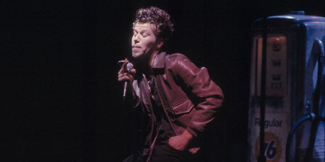 Photo of Tom Waits singing
