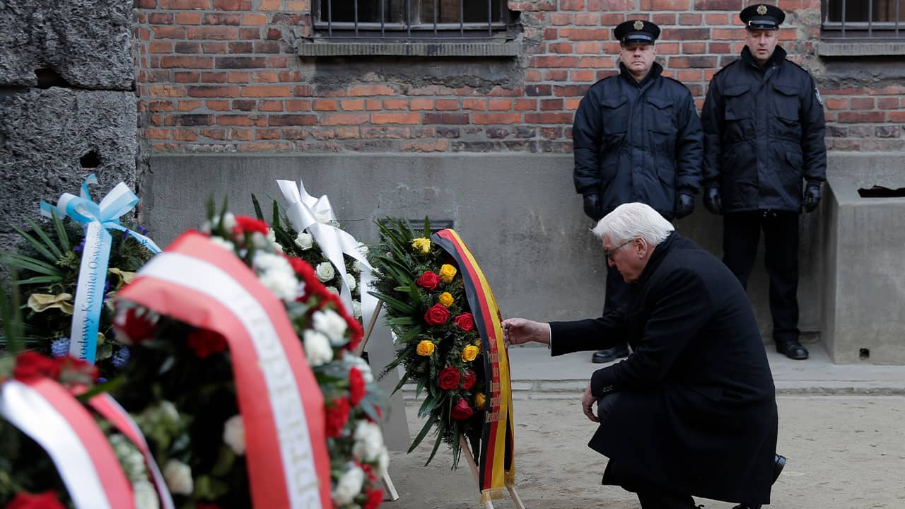Photo of Germany's President Frank-Walter Steinmeier laying a wreath at the Death Wall at the Auschwitz I Nazi death camp in Oswiecim, Poland