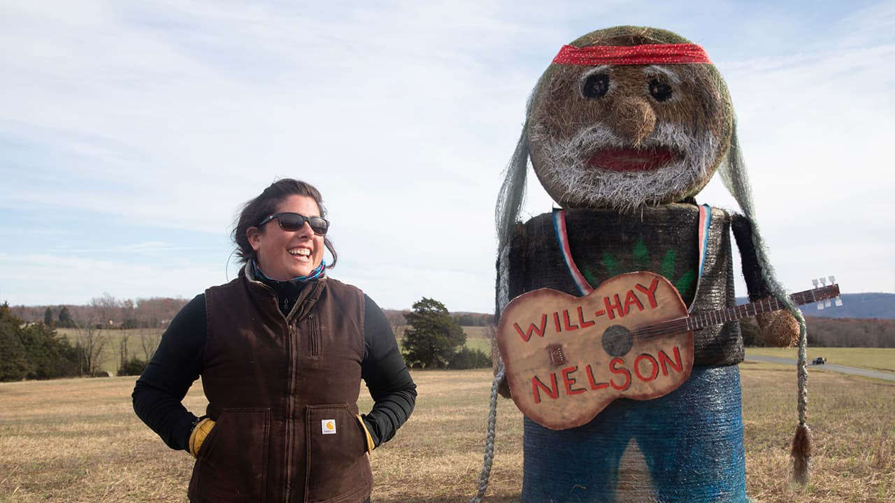 Photo of Beth Bays and her 'Will-Hay Nelson' sculpture