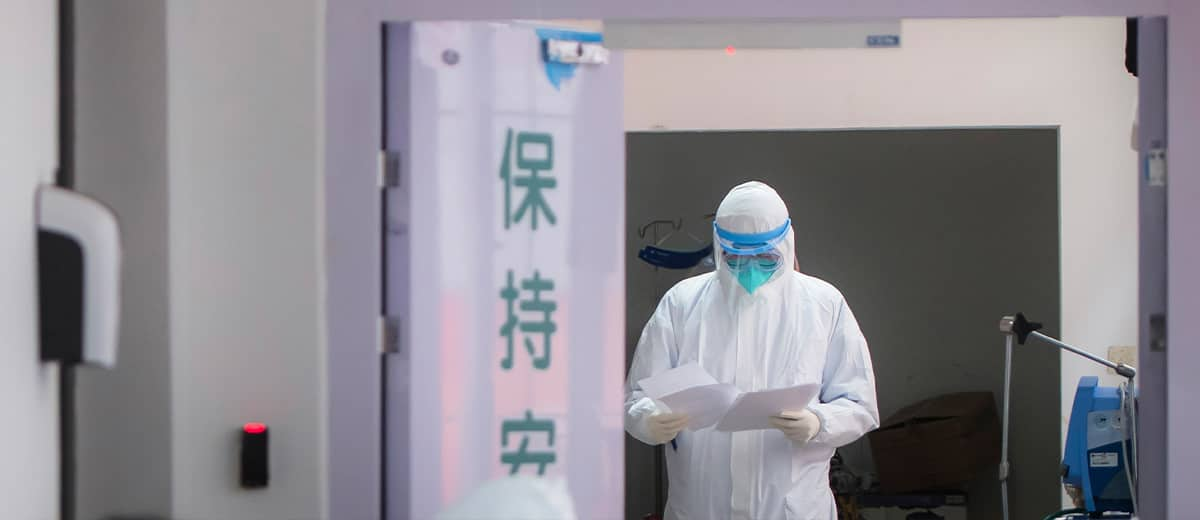 Photo of a medical staff member wearing a protective suit working at the Wuhan Union Hospital in Wuhan