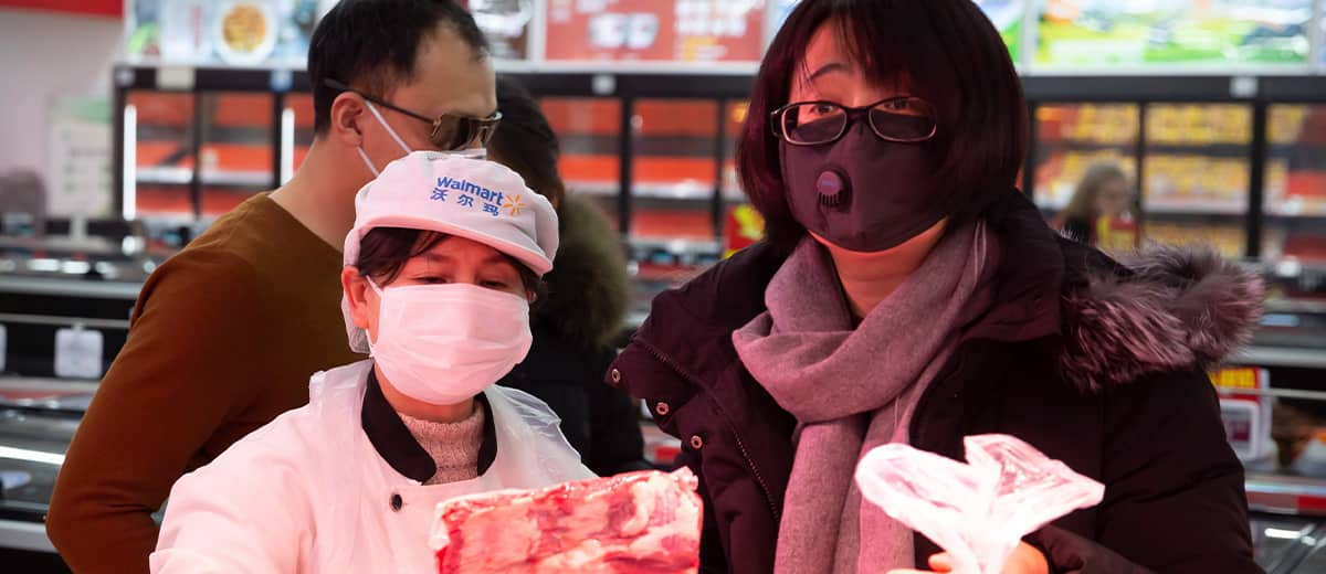 Photo of people wearing face masks as they shop for groceries at a supermarket in Beijing