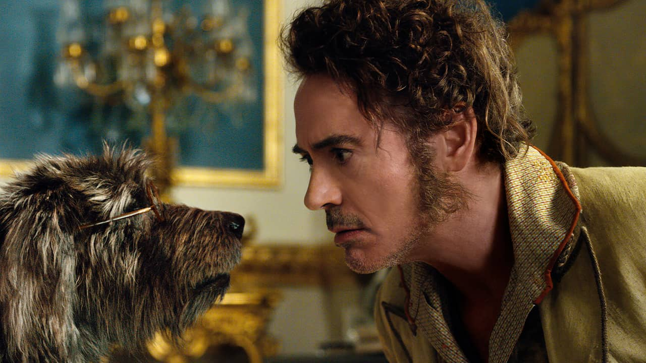 "Photo of Dr. John Dolittle, portrayed by Robert Downey Jr., right, with Jip, voiced by Tom Holland, in a scene from ""Dolittle."""