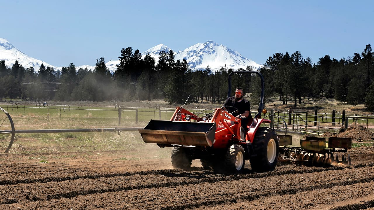 Photo of a plant manager readying a field for hemp crops