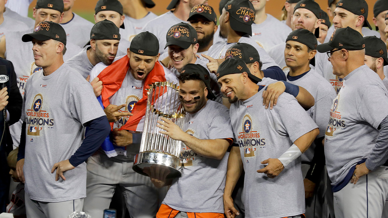 Photo of the Houston Astros celebrating with the trophy after their win against the Los Angeles Dodgers in Game 7 of baseball's World Series in Los Angeles