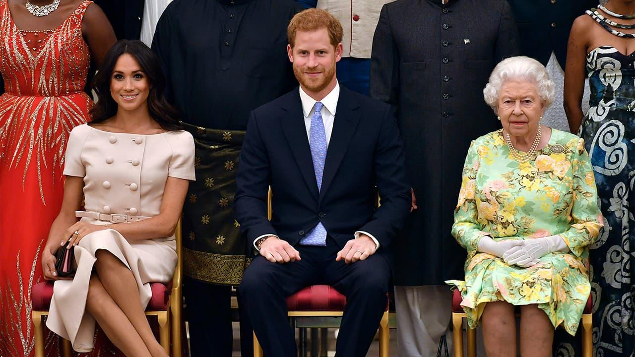 Photo of Meghan, Prince Harry, and Queen Elizabeth II
