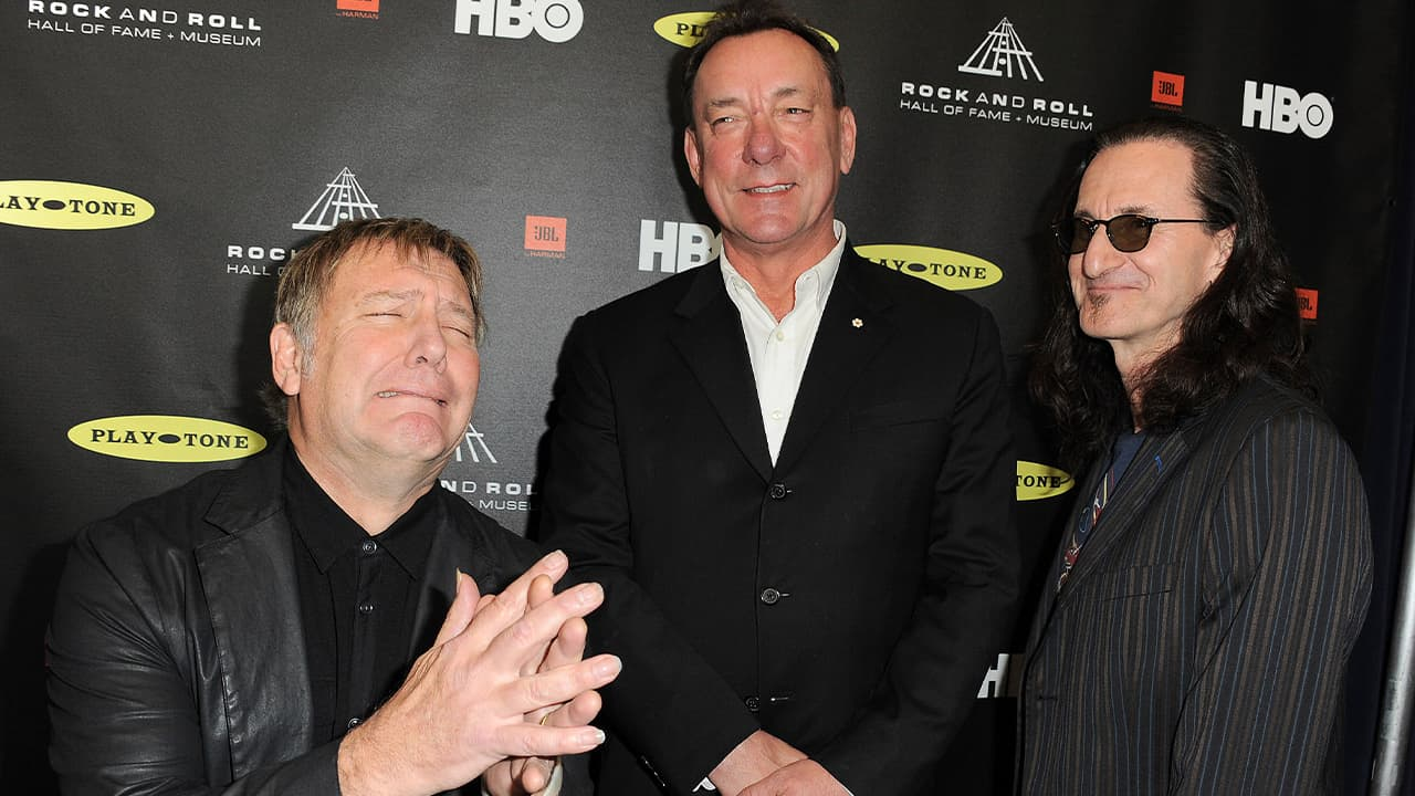 Photo of Alex Lifeson, Neil Peart, and Geddy Lee of Rush