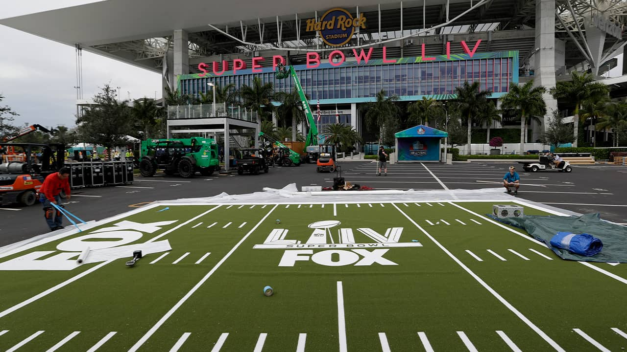 Photo of workers working on the setup outside of the Hard Rock Stadium in Miami Gardens