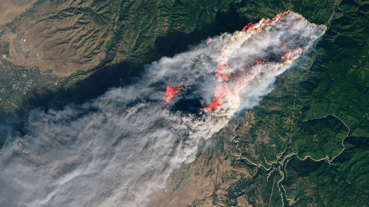 Photo of flames and smoke from the Camp Fire in 2018