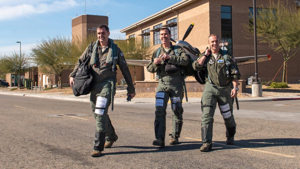 Pilots assigned to 144th Fighter Wing walk to their jets.