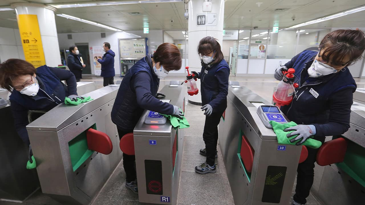 Photo of employees disinfecting ticket gates in South Korea