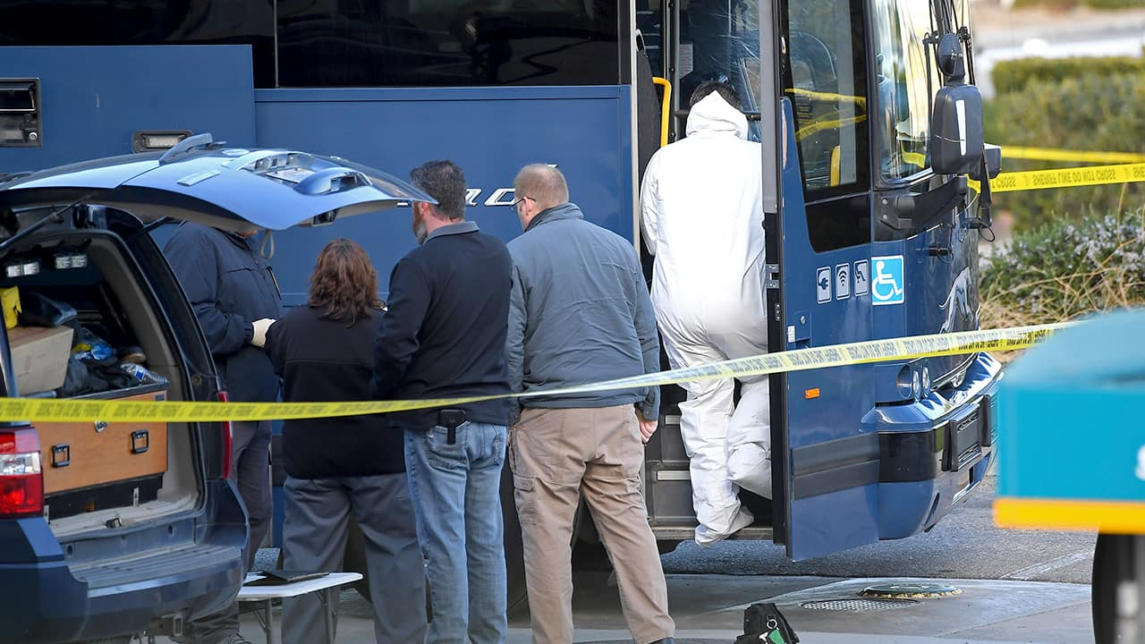 Photo of investigators outside of a Greyhound bus