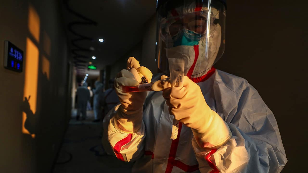 Photo of a medical worker in a protective suit