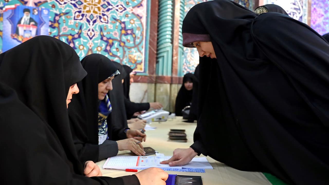 Photo of Iranian women registering to cast their votes