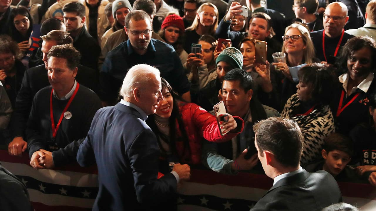 Photo of Joe Biden walking in a crowd