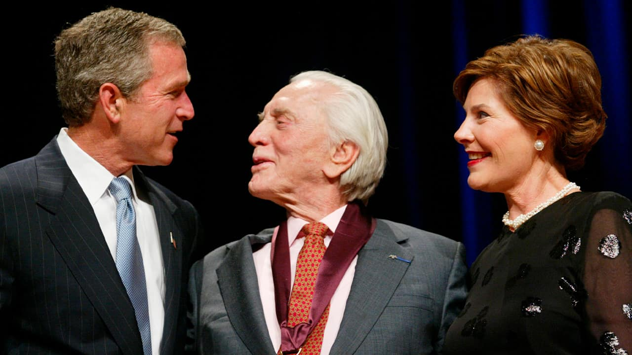 Photo of President Bush, left, with actor Kirk Douglas, center, and first lady Laura Bush, right