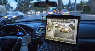 Photo of a patrol officer using a license plate reader camera