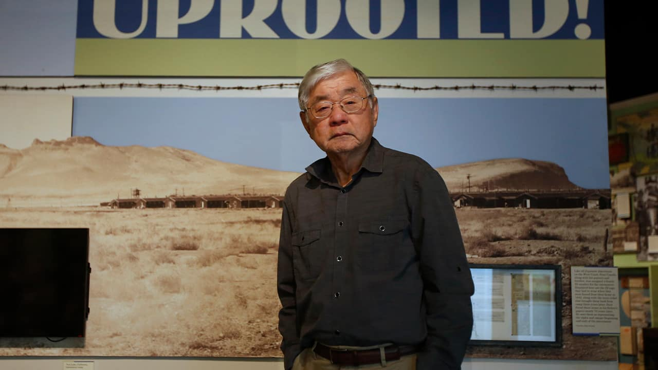 """Photo of Les Ouchida at the permanent exhibit titled """"UpRooted Japanese Americans in World War II"""" at the California Museum in Sacramento"""