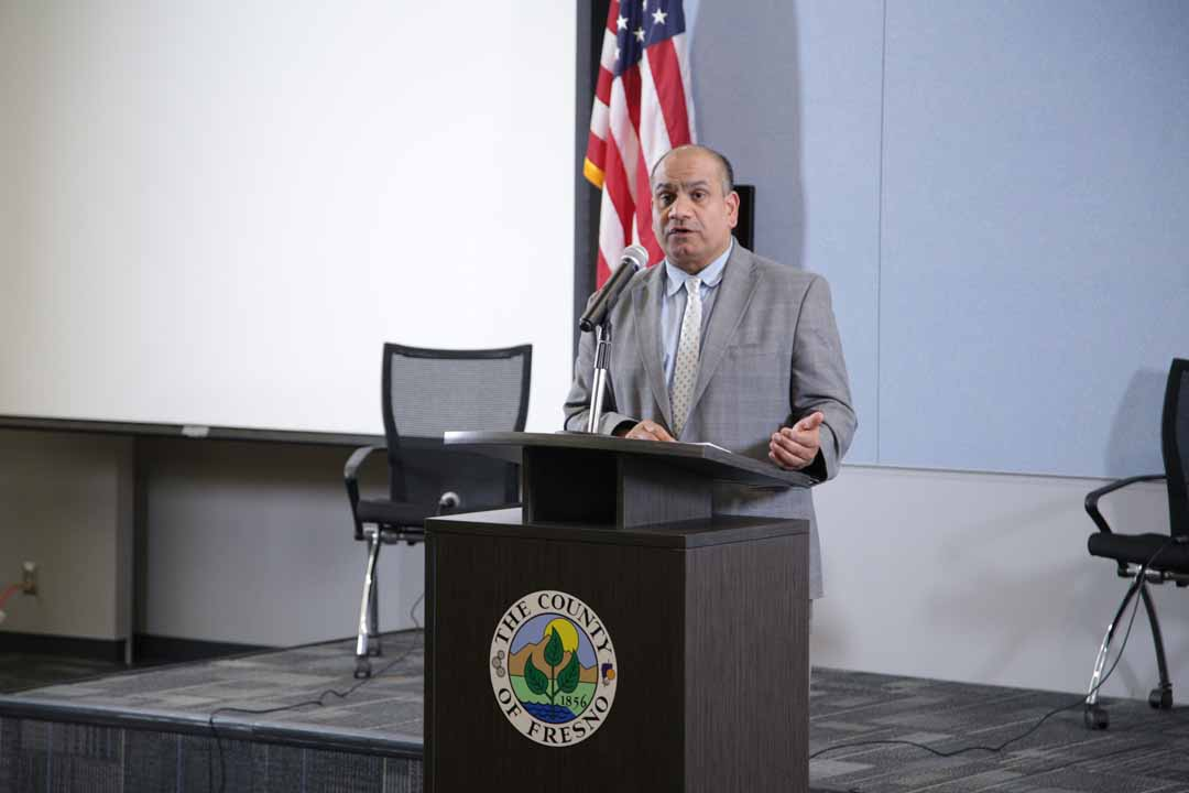 Photo of Dr. Rais Vohra speaking at a news conference
