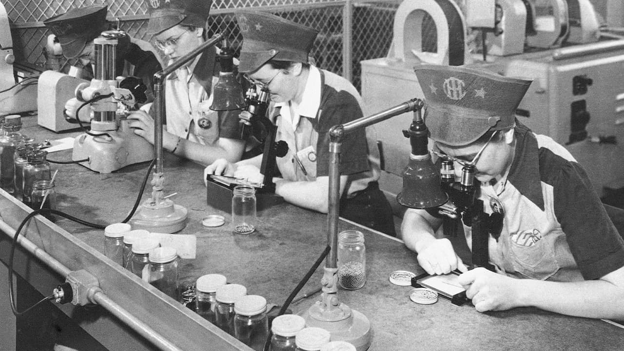 Photo of factory workers inspecting ball bearings in 1943