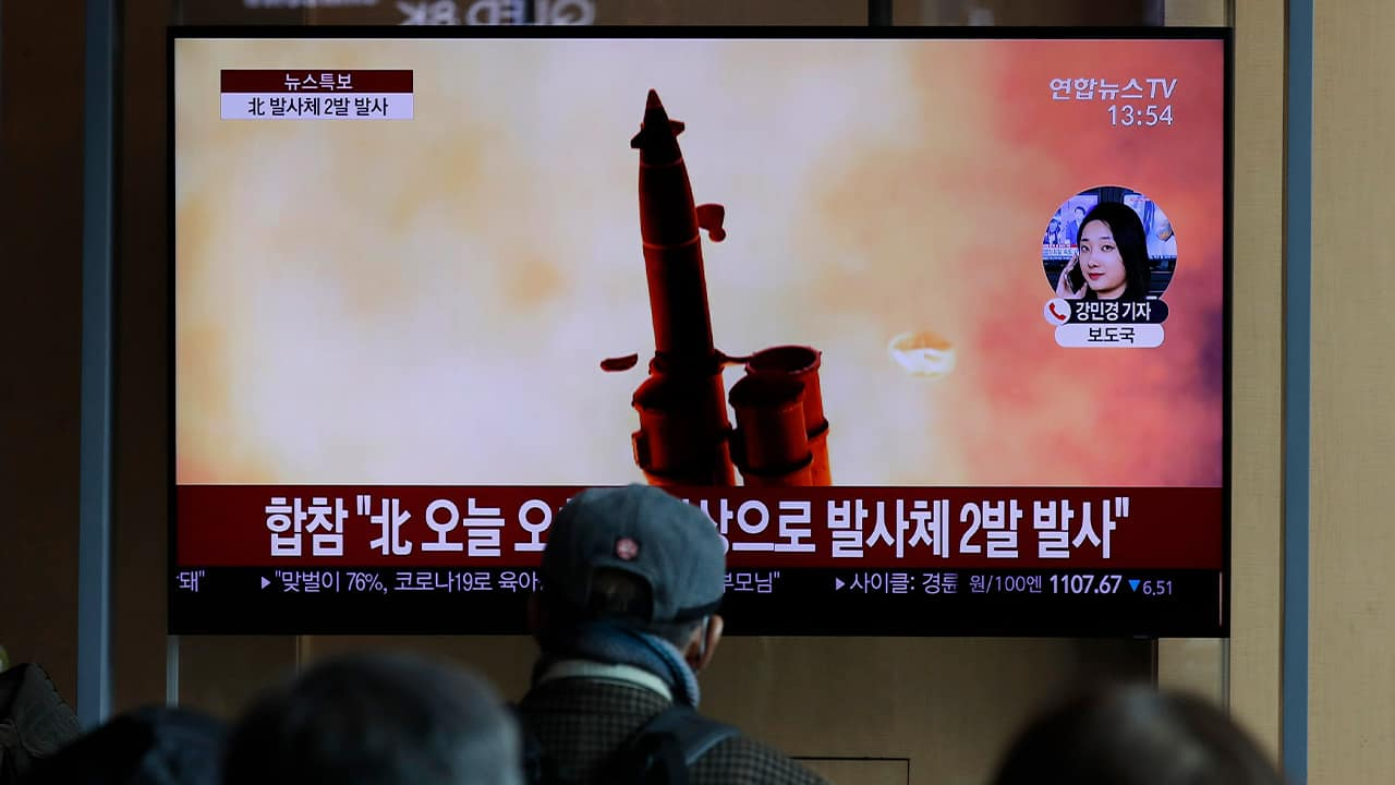 Photo of a news program reporting about North Korea's firing of projectiles