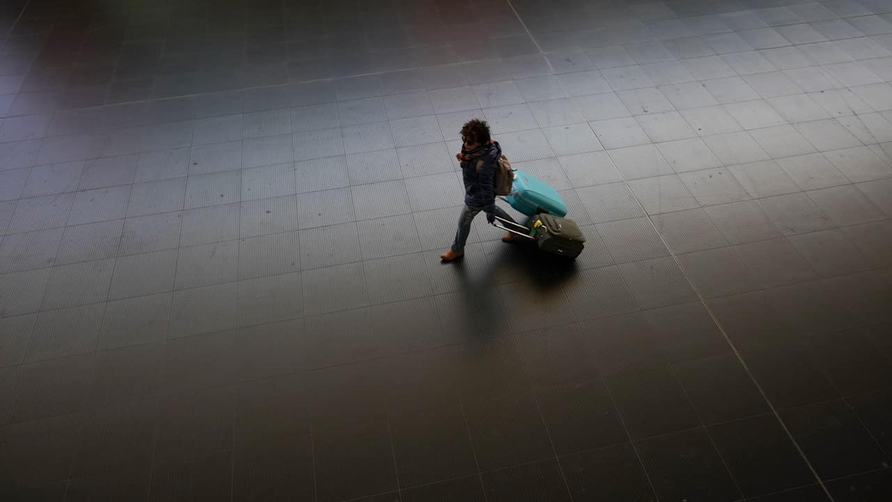 Photo of a person at a train station in Spain