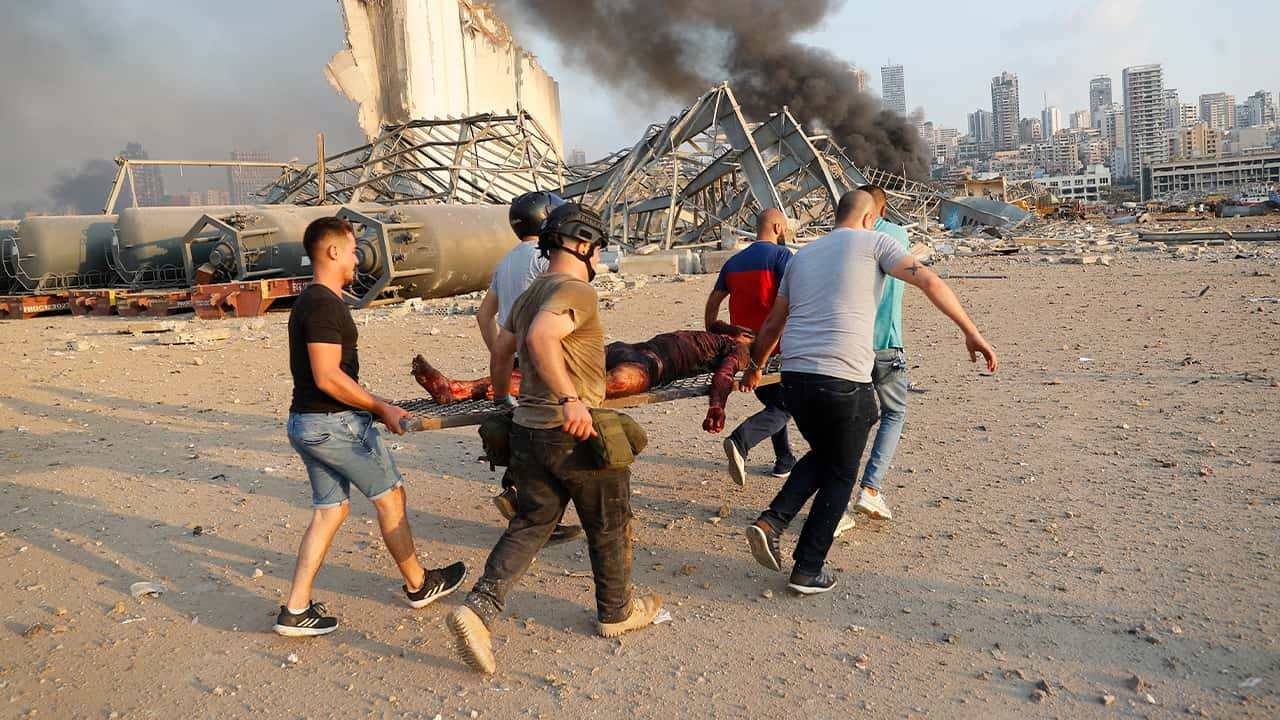 Photo of civilians carrying a victim