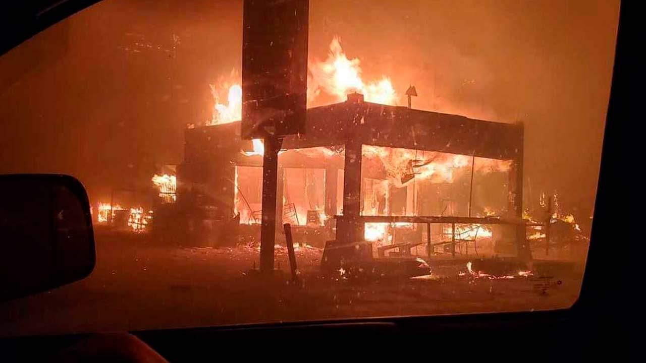 Photo of Cressman's Store burning below Shaver Lake during the Creek Fireel