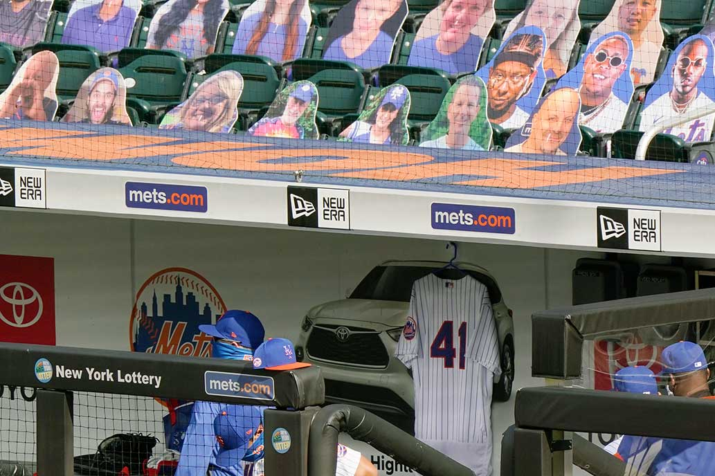 A photo of Tom Seaver's No. 41 jersey hangs in the New York Mets dugout in tribute to the Hall of Famers